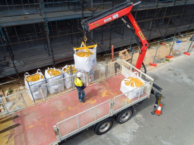 Hiab Delivery (up to 10 bags) to a multi-storey apartment site - Delivery by flat top semi trailer also available (up to 24 bags)